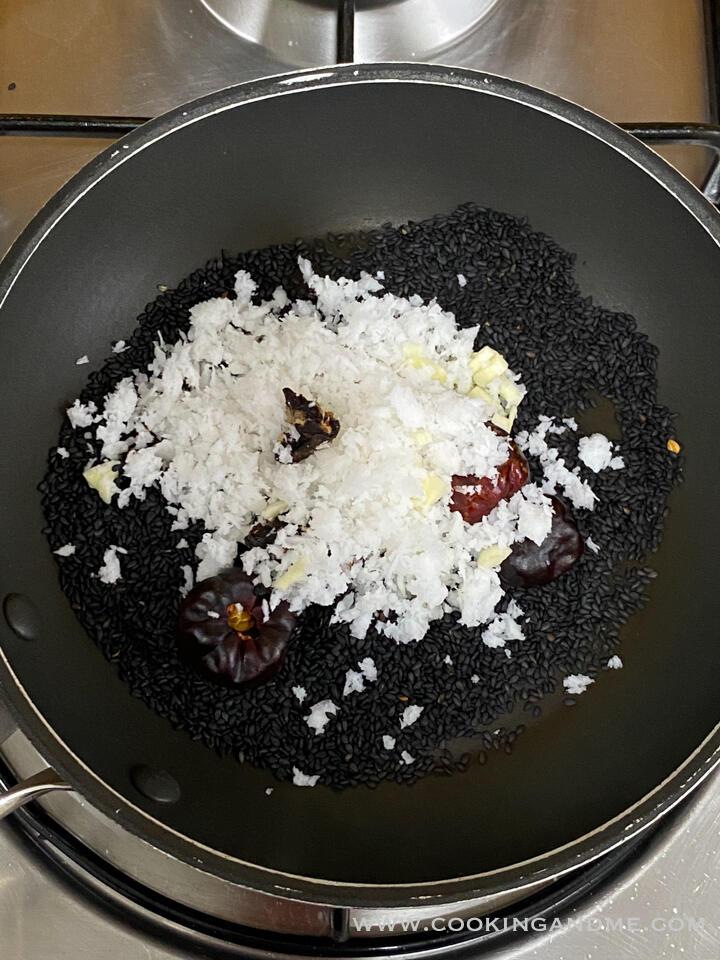 adding coconut to ellu chutney